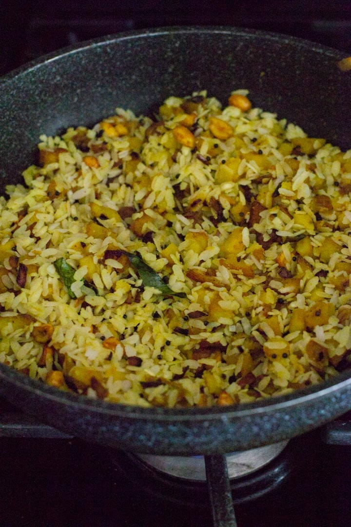 Poha is added to the onion-potato mixture