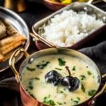 Gujarati Kadhi served with rice, potato sabzi and rotis