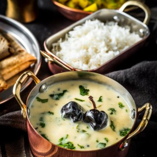 Gujarati Kadhi served with rice, potato sabzi and rotis