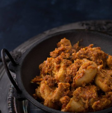 "If you like your chicken spicy, you will love this popular Mangalorean dish called ""Kori Ajadina,"" which literally means ""Dry Chicken."" Made using chicken, grated coconut and Kundapur Masala powder, Kori Ajadina with its lovely aroma of spices, is usually served as an accompaniment to rice and chicken curry."