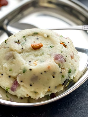 Rava upma served in a steel plate