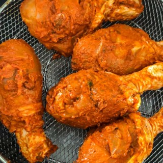 Place the marinated chicken on the trivet or the air frying basket