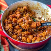 Chana Suran served in red Le creuset