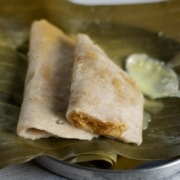 Gatti - rice dumplings stuffed with grated coconut and jaggery.
