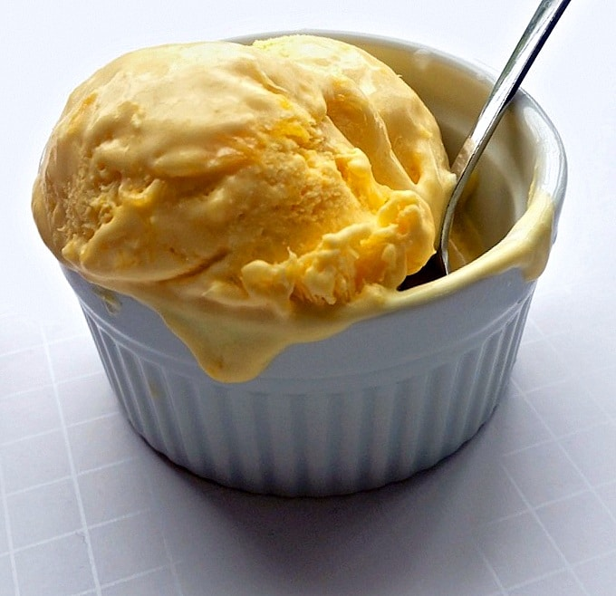 Mango ice cream served in a white bowl