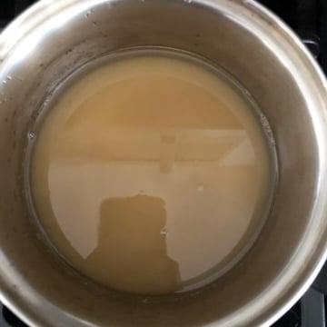 Sugar syrup in a silver bowl.