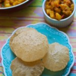 An overhead shot of pooris served with Aloo sabzi (Potato curry)