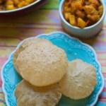 An overhead shot of pooris served with Aloo sabzi (Potato curry)