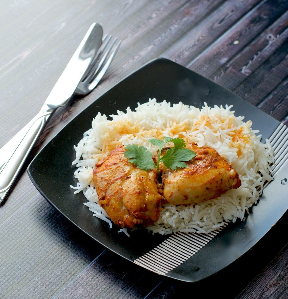 Mangalorean style baked chicken is an unique spin on the classic baked chicken with a spicy kick of Mangalorean Curry Masala.