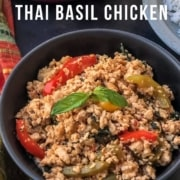 The words 20 Minute Thai Basil Chicken at the top with a black bowl of thai basil chicken topped with bell peppers and basil.