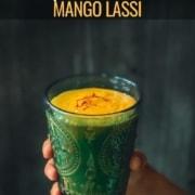A hand holding mango lassi