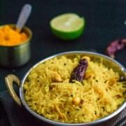 Lemon rice served in a steel bowl