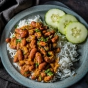 An overhead shot of rajma chawal served on a gray plate.