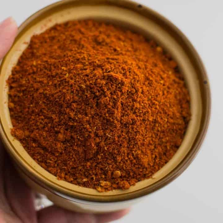An overhead shot of Kundapur Masala in a brown bowl