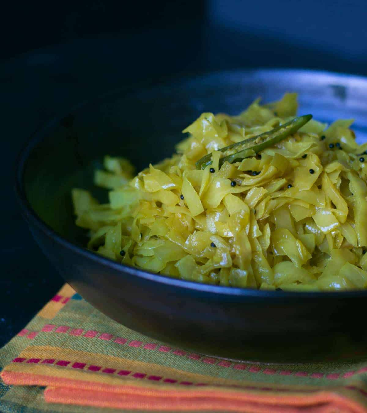 Simple, yet flavorful Cabbage sukka or palya is a stir-fried cabbage dish that pairs well with steamed rice and sambar to make a perfect afternoon meal.