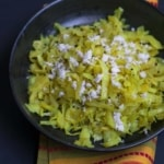 Cabbage Palya or Sukka Recipe - This simple, yet flavorful stir-fried cabbage preparation pairs well with steamed rice and sambar and makes for a perfect afternoon meal.