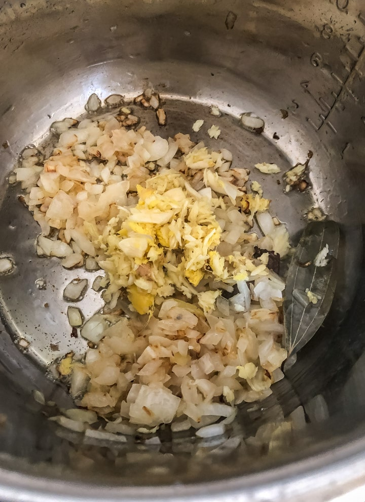 Add ginger and garlic to softened onions