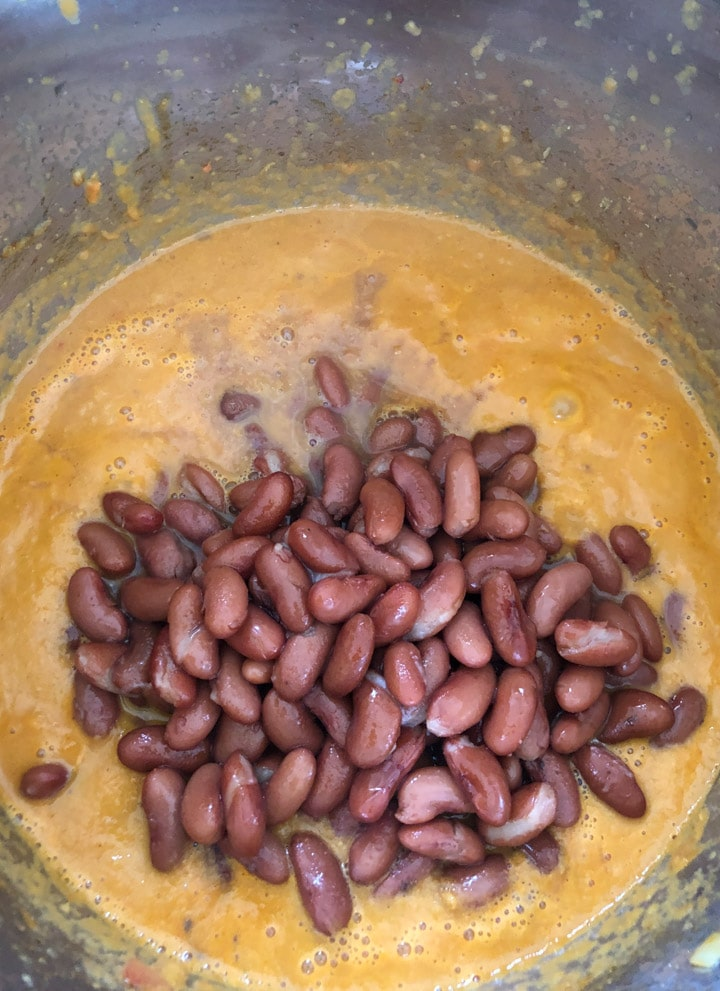 Add pressure cooked rajma to the gravy