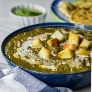 Palak paneer served in a blue bowl