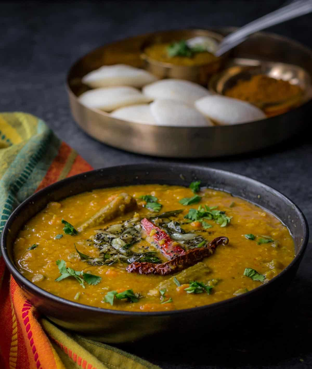 Sambar or Sambhar is a tangy and mildly spicy lentil-vegetable stew from the southern part of India. It is a staple in most South Indian homes and is served alongside idlis or dosas for breakfast or with rice for lunch/dinner.