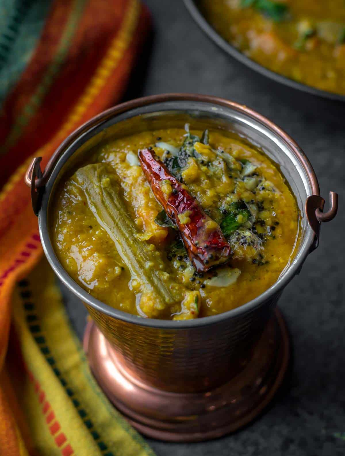 Sambar or Sambhar - Make this tangy and mildly spicy lentil-vegetable stew from the southern part of India and serve it alongside idlis or dosas for a wholesome breakfast.