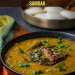Sambar served in a black bowl