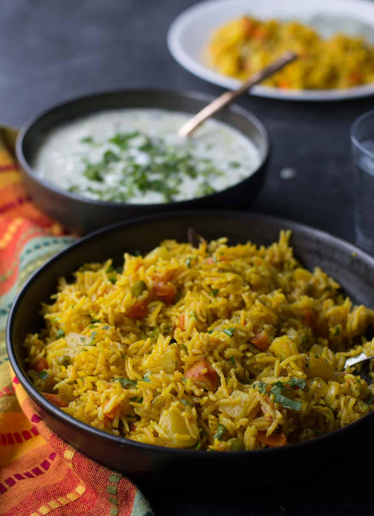 Instant Pot Vegetable biryani served with raita