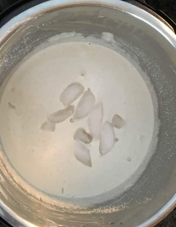Ice cubes added to Idli batter left in an Instant Pot for fermenting