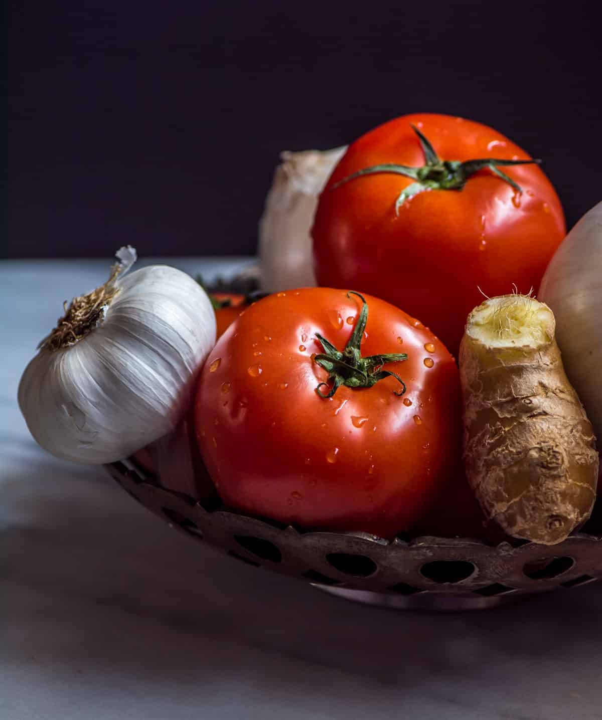 Ingredients used in a curry sauce - tomatoes, onions, ginger, and garlic