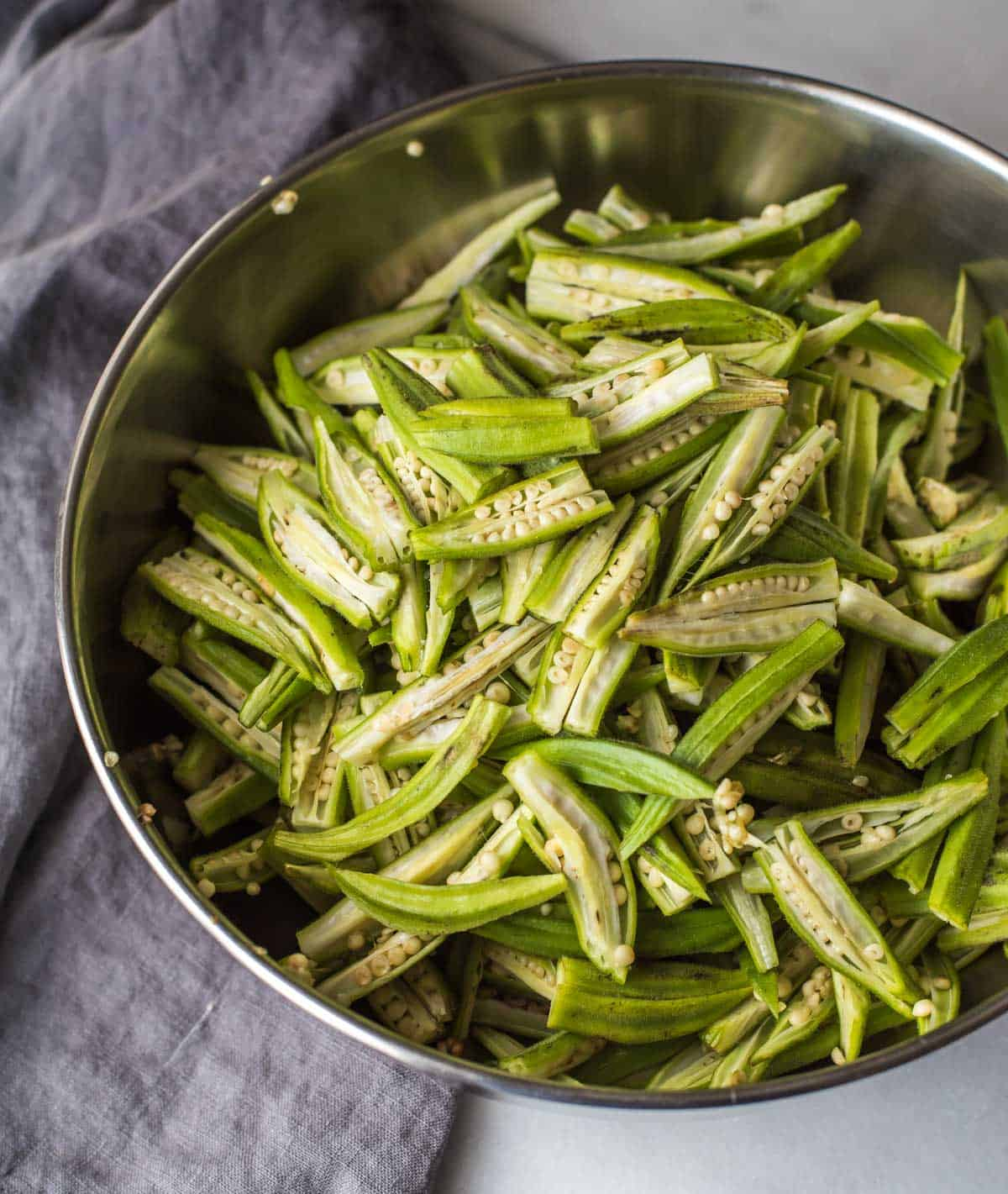 Okras cut lengthwise for the bhindi do pyaza recipe