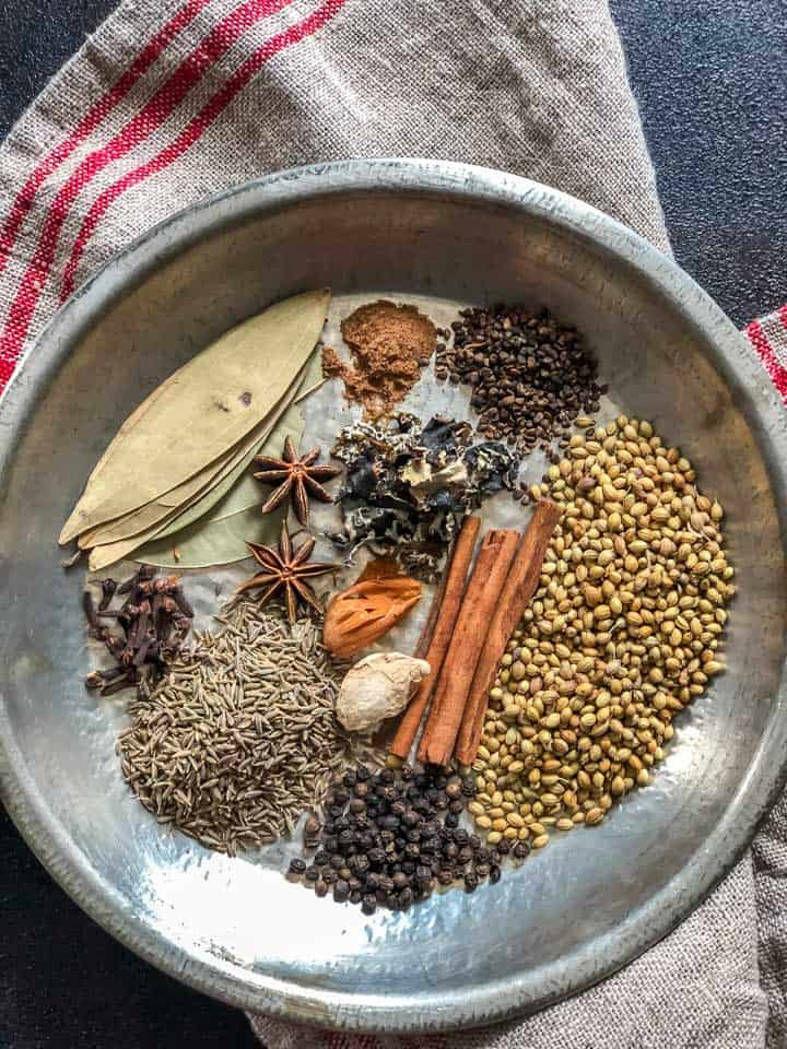 Garam masala ingredients kept on a plate