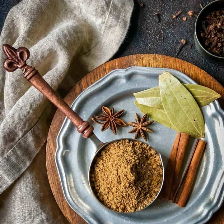 1/2 cup measuring cup filled with garam masala