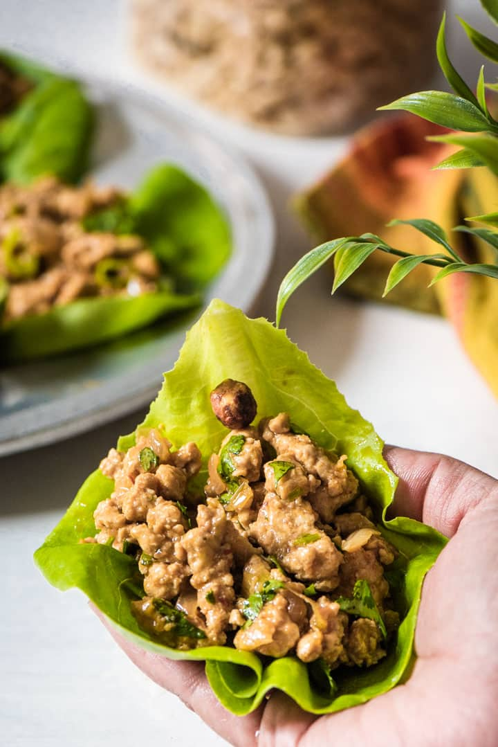Lettuce wraps held in a palm