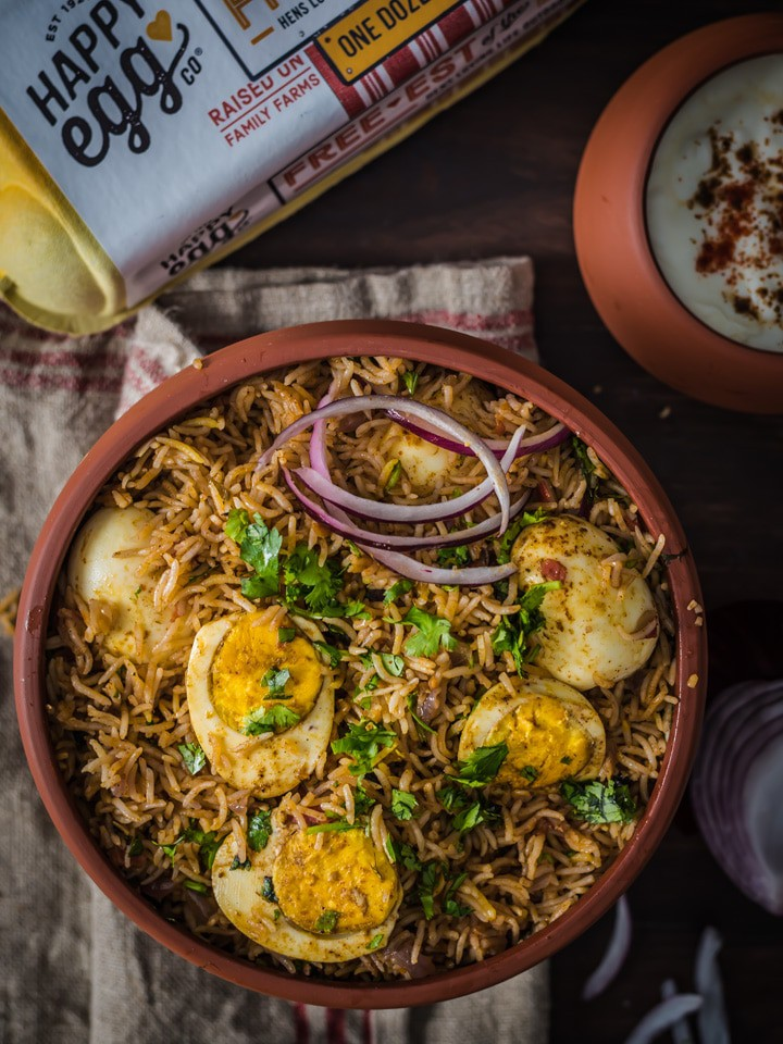 Egg biryani served in a brown bowl
