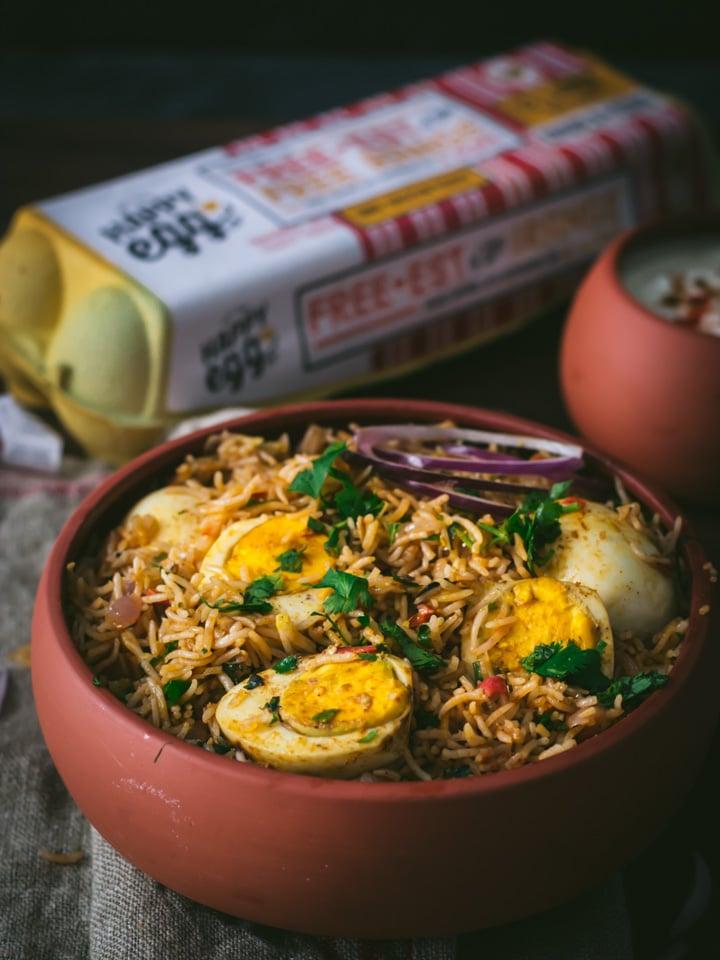 Egg biryani served in a brown bowl