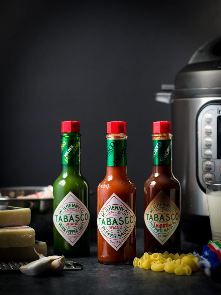 TABASCO sauce bottles are shown in 3 different flavors along with the ingredients to make mac and cheese and an Instant Pot