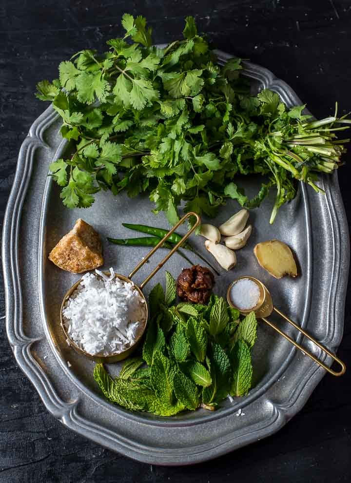 Ingredients used in Cliantro Mint Chutney - Cilantro, Mint leaves, Jaggery, Garlic, Tamarind and Salt