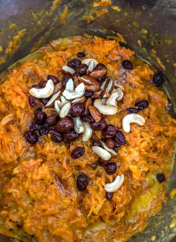 Adding fried dried fruits to carrot halwa