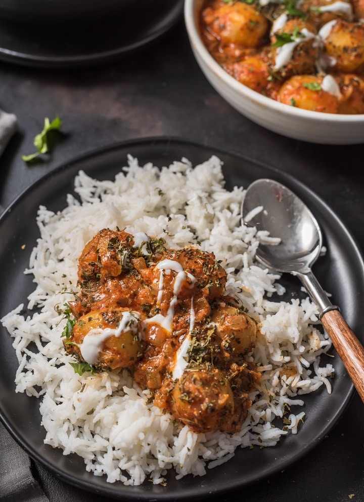 An overhead shot of Dum Aloo served over rice