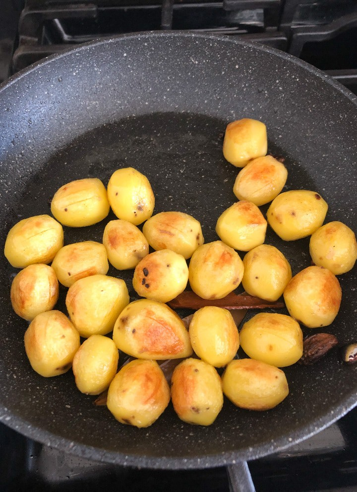 Shallow frying potatoes for dum aloo
