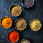 7 spices stored in a stainless steel container