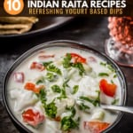 Cucumber tomato raita served in a black bowl and is accompanied by rotis and a glass of raspberry lemonade
