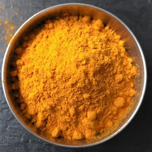An overhead shot of turmeric powder