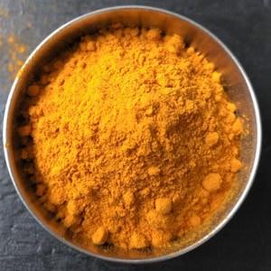 An overhead shot of turmeric powder