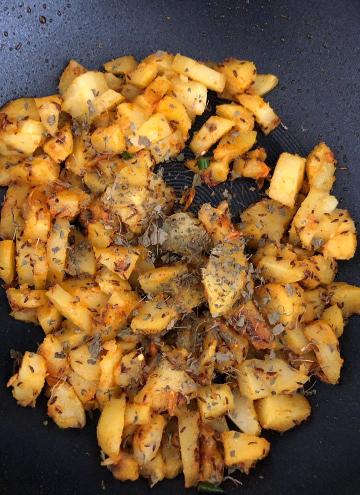Cooked Aloo Jeera in a wok