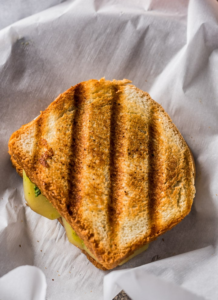 Grilled Bombay Sandwich placed on parchment paper