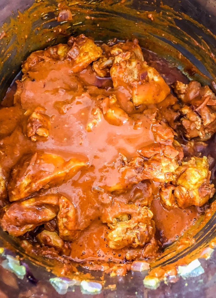 Add water to the chicken curry