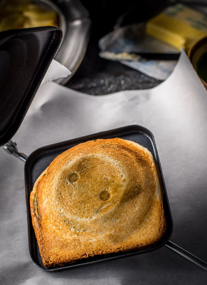Grilled sandwich toasted on a stovetop sandwich maker