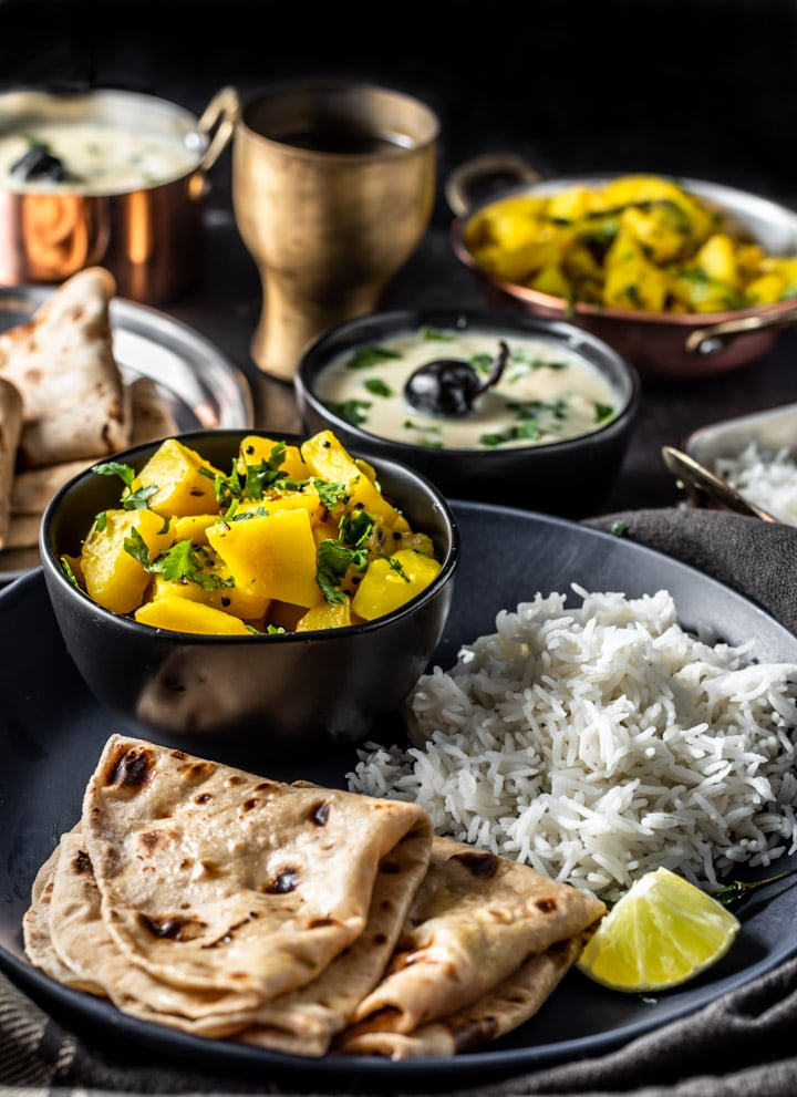 Potato bhaji served with rice, kadhi and chapati
