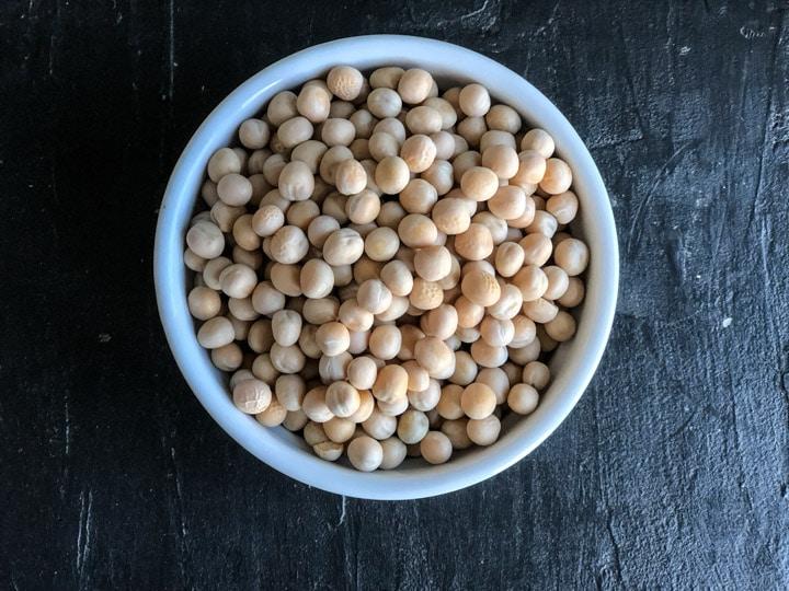 Safed vatana (dried white peas) in a white bowl